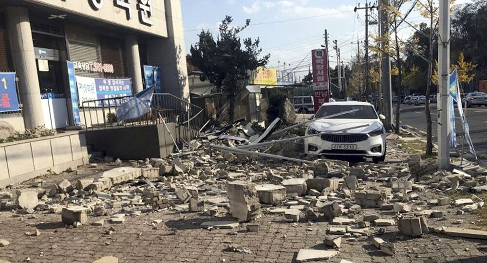 Debris from a collapsed wall is scattered in front of a shop after an earthquake in Pohang, South Korea