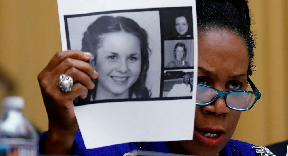 Rep. Sheila Jackson Lee (D-TX) holds up pictures of women who've accused U.S. Senate candidate Roy Moore of sexual misconduct, while questioning U.S. Attorney General Jeff Sessions (Not Pictured) during the House Judiciary Committee oversight hearing on Capitol Hill in Washington, U.S., November 14, 2017