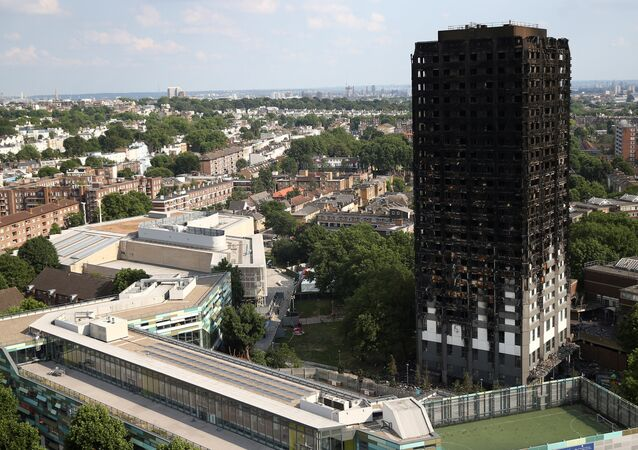 The burnt out remains of the Grenfell apartment tower are seen in North Kensington, London, Britain, June 18, 2017.