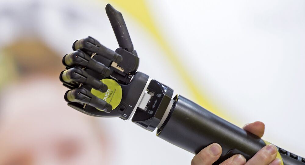 A man presents the bionic prosthesis 'i-limb quantum'at the stand of the company Touch Bionics of Great Britain during the international trade show and world congress OTWorld in Leipzig, eastern Germany. (File)