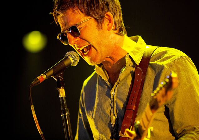 Noel Gallagher performs on stage with his band High Flying Birds, playing at The Roskilde Festival which opened on Wednesday, July 1, 2015.