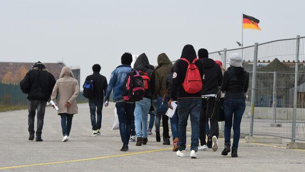 Migrants arrive at the first registration point for asylum seekers in Erding near Munich, southern Germany, on November 15, 2016 - Sputnik International