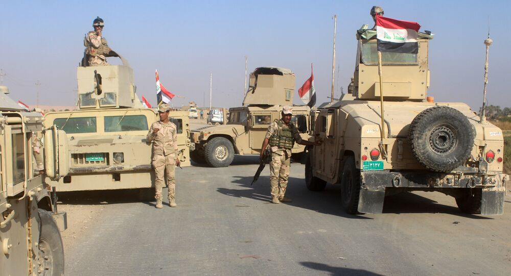 Iraqi security forces gather in the Rawa area during an operation to retake the Euphrates Valley town from the Islamic State group on November 11, 2017