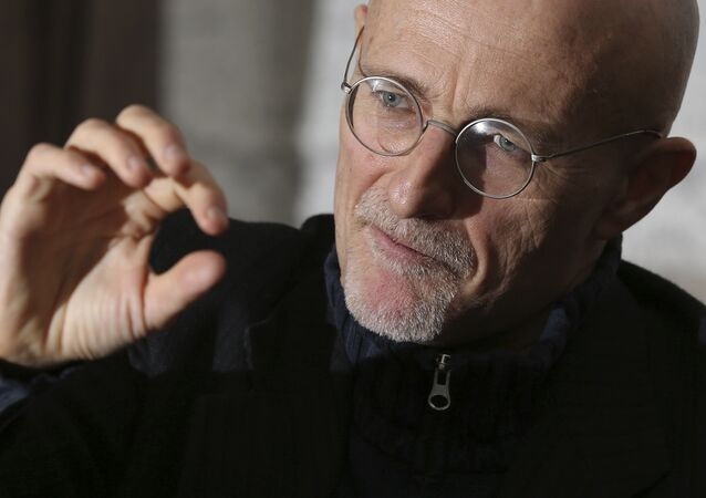 Professor Sergio Canavero gestures as he speaks to the media during a press conference in Glasgow, Scotland, Friday Nov. 18, 2016