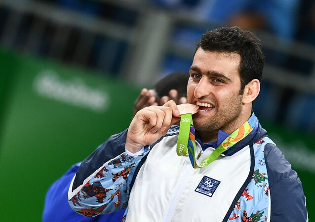 Sabakh Shariati (Azerbaijan), winner of the bronze medal in the Greco-Roman wrestling competition in the under 130kg division at the XXXI Summer Olympics, during the medal ceremony. File photo