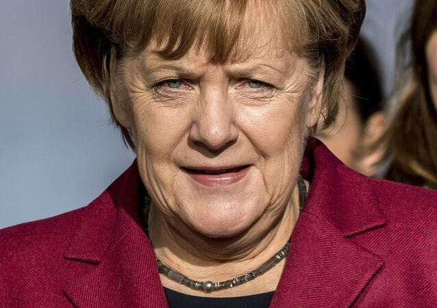 German Chancellor Angela Merkel arrives for another round of pre-talks on forming a new German government at the headquarters of her Christian Democratic Union in Berlin Friday, Nov. 17, 2017.