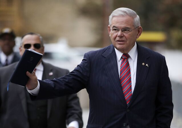 U.S. Sen. Bob Menendez waves at reporters before entering the Martin Luther King Jr. Federal Courthouse for his federal corruption trial, Thursday, Nov. 16, 2017, in Newark, N.J. Jury deliberations continued on Thursday morning.