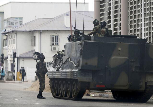 A military vehicle is seen on a street in Harare, Zimbabwe, Thursday, Nov. 16, 2017