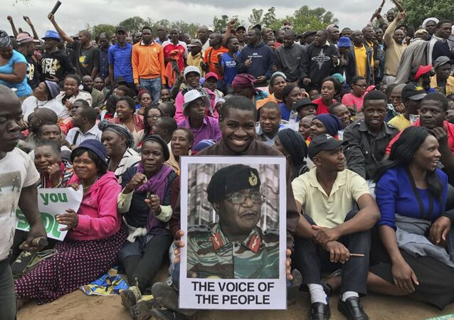 People gather to demonstrate for the ouster of 93-year-old President Robert Mugabe who is virtually powerless and deserted by most of his allies, in Harare, Zimbabwe, Saturday, Nov. 18, 2017