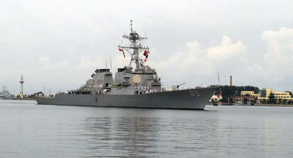 The guided missile destroyer USS Benfold arrives in port in Qingdao in eastern China's Shandong Province, Monday, Aug. 8, 2016