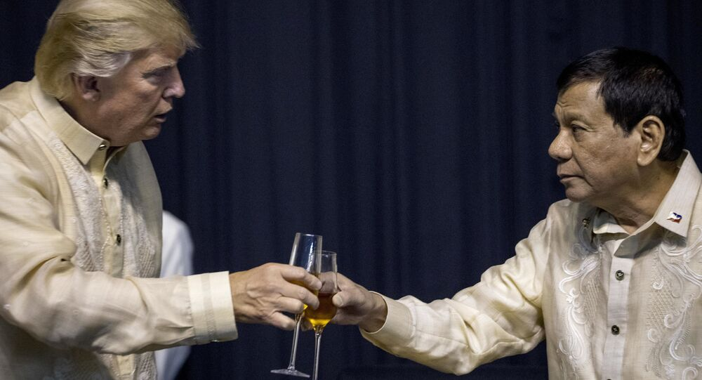 President Donald Trump toasts Philippines President Rodrigo Duterte, right, at an ASEAN Summit dinner at the SMX Convention Center, Sunday, Nov. 12, 2017, in Manila, Philippines