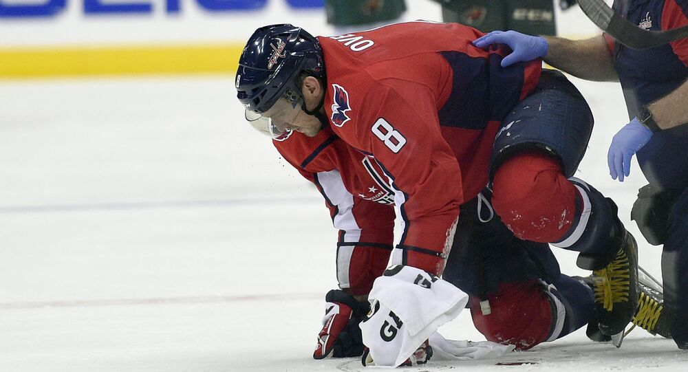 Washington Capitals left wing Alex Ovechkin (8), of Russia, is helped by a trainer after he was injured during the second period of an NHL hockey game against the Minnesota Wild, Saturday, Nov. 18, 2017, in Washington