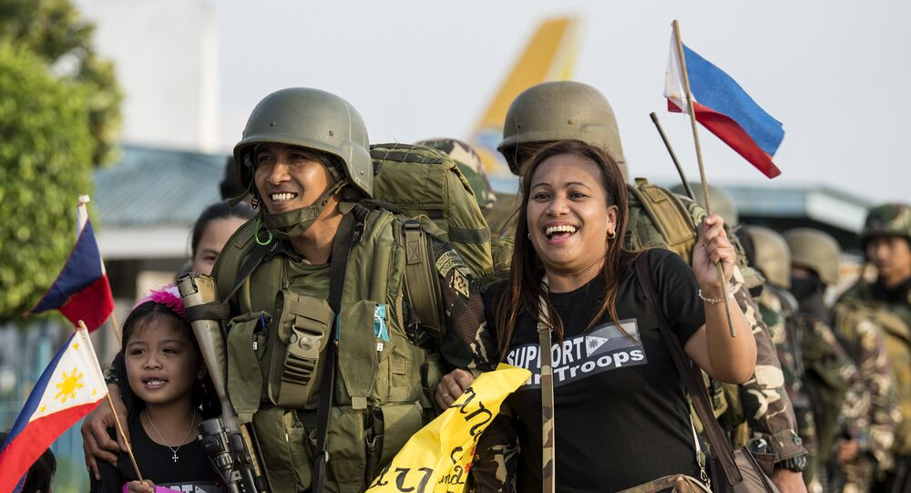 Philippine soldiers from Marawi are welcomed home by their relatives at Villamor Airbase in Manila on October 20, 2017