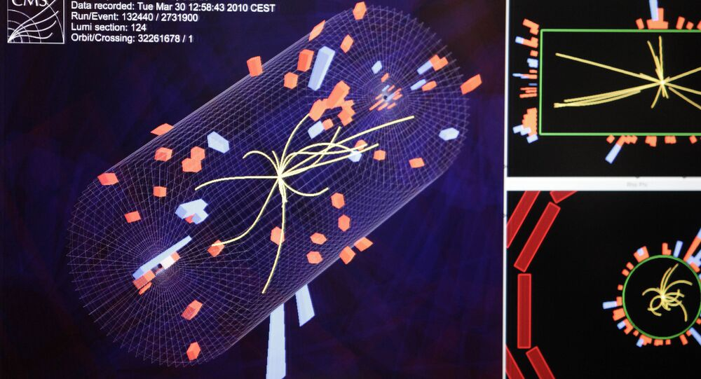 An event display shows the activity during a high-energy collision at the CMS control room of the European Organization for Nuclear Research, CERN, at their headquarter outside Geneva, Switzerland