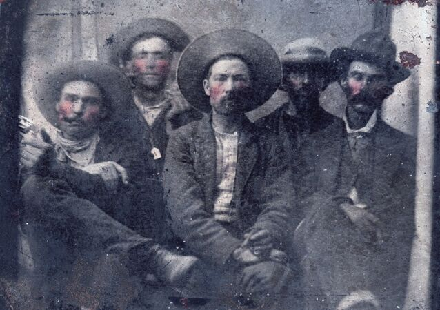 This photo provided by Frank Abrams shows what historians believe is a photo of outlaw Billy the Kid, second from left, and Pat Garrett, far right, taken in 1880. Frank Abrams, who bought the photo at a flea market says experts in forensics and facial recognition have verified the picture after several months of examination