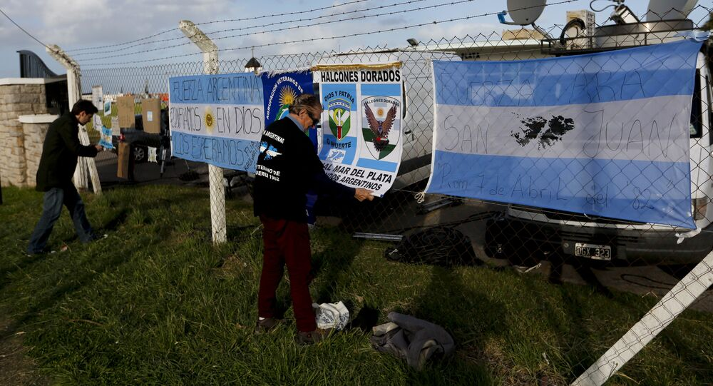 Banners with messages in support of the crew of the Argentine submarine ARA San Juan hang from the fence at the Navel base in Mar del Plata, Argentina, Sunday, Nov. 19, 2017