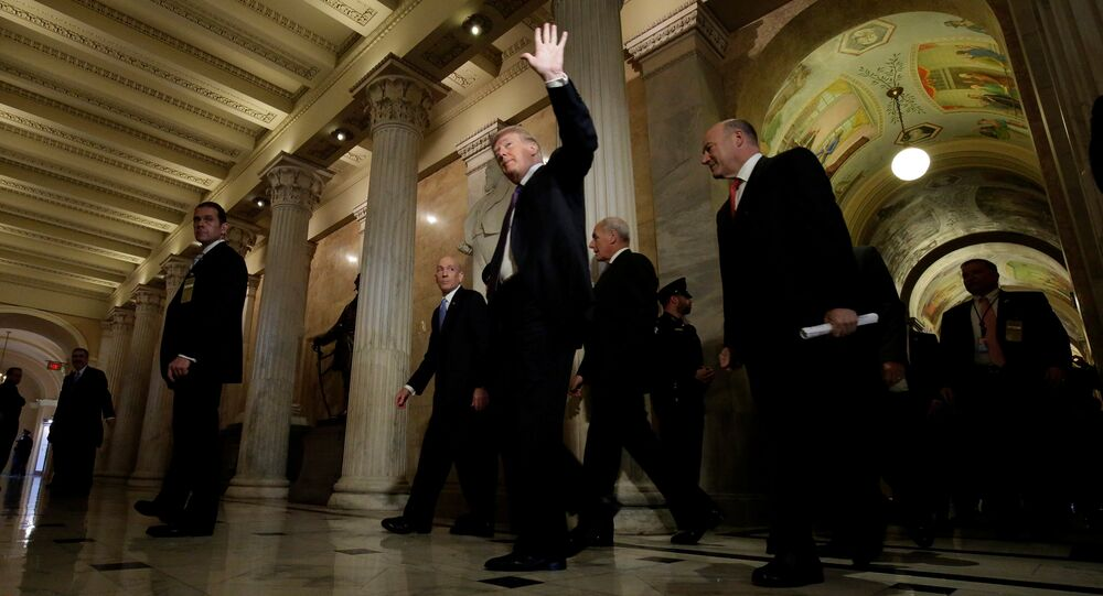 U.S. President Donald Trump arrives with Director of the National Economic Council Gary Cohn at the U.S. Capitol to meet with House Republicans ahead of their vote on the Tax Cuts and Jobs Act in Washington, U.S., November 16, 2017