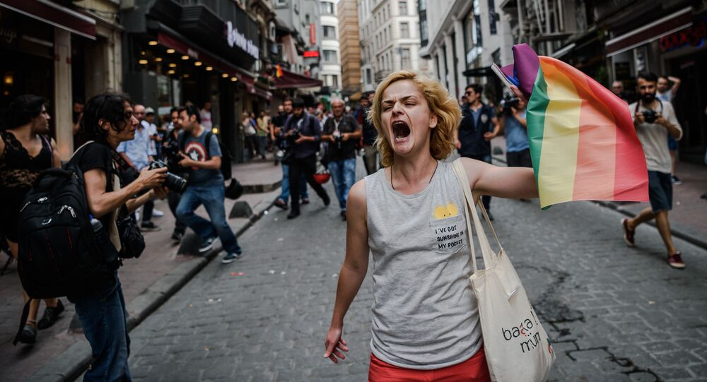 A LGBT member waves a rainbow flag during a rally staged by the LGBT community on Istiklal avenue in Istanbul on June 26, 2016