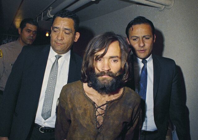 In this 1969 file photo, Charles Manson is escorted to his arraignment on conspiracy-murder charges in connection with the Sharon Tate murder case