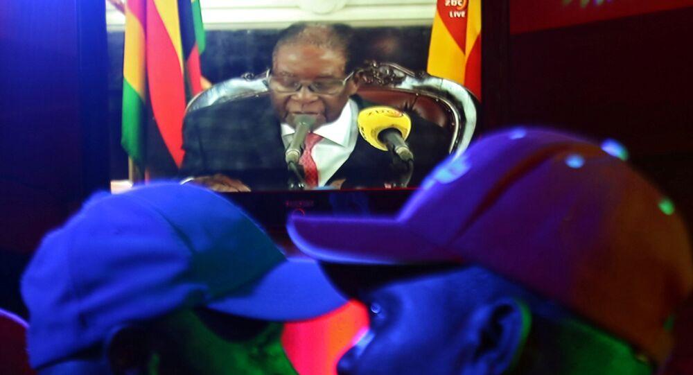 People watch as Zimbabwean President Robert Mugabe addresses the nation on television, at a bar in Harare, Zimbabwe, November 19, 2017