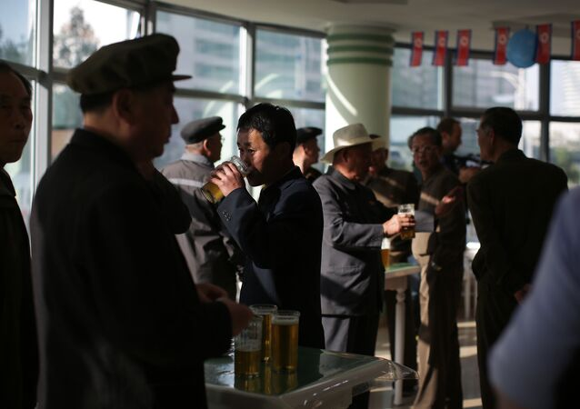 In this Saturday, May 7, 2016, photo, North Korean men drink beer at the Taedonggang Beer shop in Pyongyang, North Korea