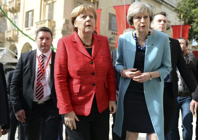 German Chancellor Angela Merkel, left, speaks with British Prime Minister Theresa May, right, as they walk with other EU leaders during an event at an EU summit in Valletta, Malta. File photo
