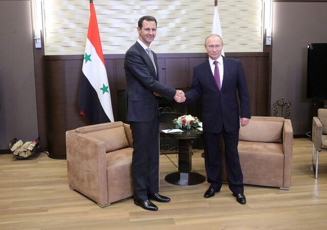 Vladimir Putin meets with Syrian President Bashar Al-Assad