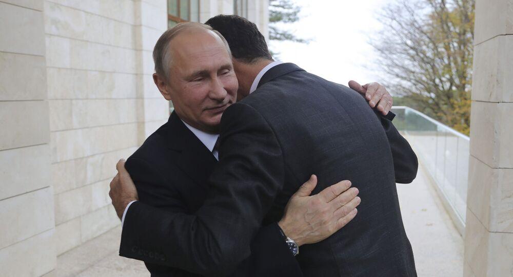 Russian President Vladimir Putin (L) welcomes Syrian President Bashar al-Assad during a meeting in the Black Sea resort of Sochi, Russia November 20, 2017. Picture taken November 20, 2017