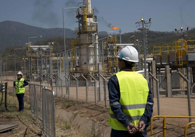 Oil workers stand at the new Incahuasi natural gas plant in Lagunillas, Bolivia, Friday, Sept. 16, 2016