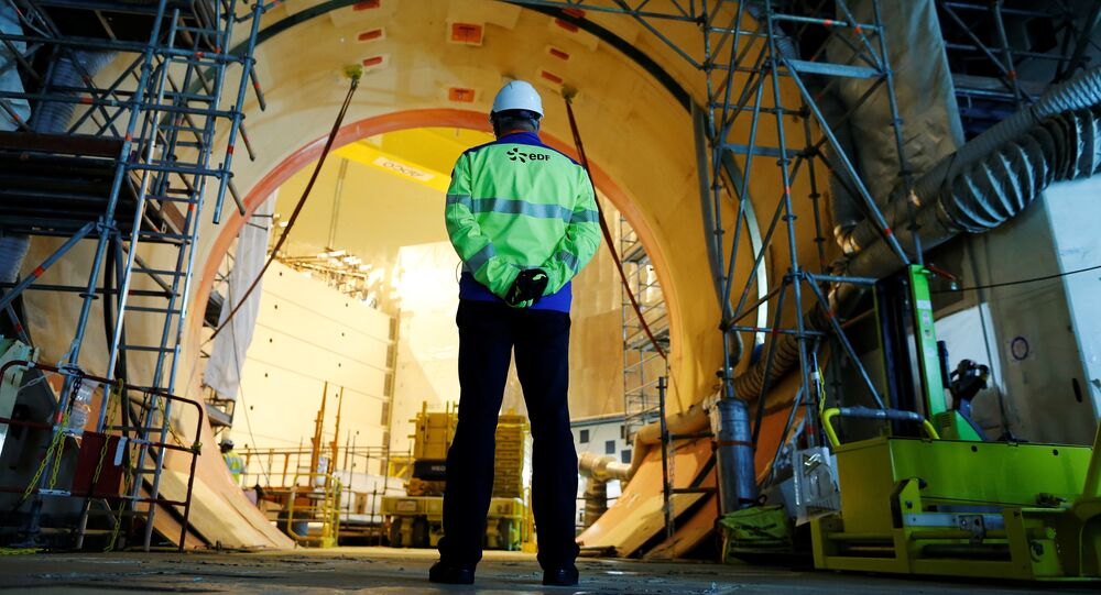 A worker stands in the construction site of the third-generation European Pressurised Water nuclear reactor (EPR) in Flamanville, northwestern France on November 16, 2016