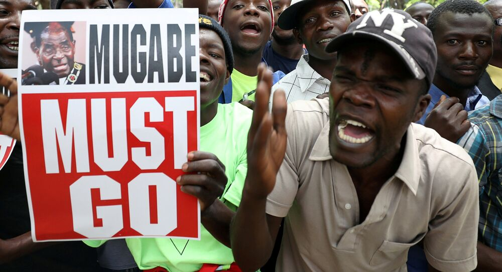 Protesters call for Zimbabwean President Robert Mugabe to resign across the road from parliament in Harare, Zimbabwe, November 21, 2017