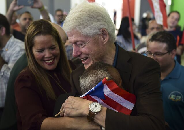 Former President Bill Clinton hugs a resident living at the William Rivera Betancourt Vocational School which was turned into an emergency shelter for families affected by the impact of Hurricane Maria, in Canovanas, Puerto Rico, Monday, Nov. 20, 2017
