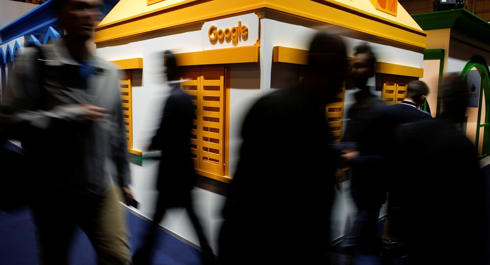 People pass by the Google stand at the Web Summit, Europe's biggest tech conference, in Lisbon, Portugal, November 8, 2017