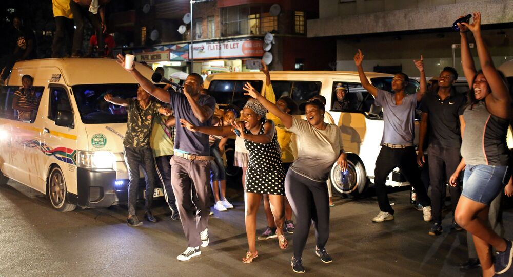 Zimbabweans living in South Africa celebrate after President Robert Mugabe resigns, in Johannesburg, South Africa November 21, 2017