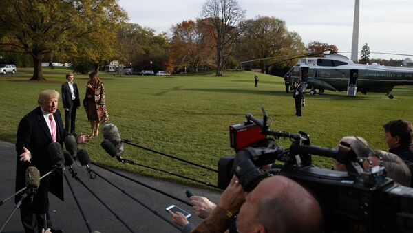 President Donald Trump speaks to reporters before leaving the White House, Tuesday, Nov. 21, 2017, in Washington for a Thanksgiving trip to Mar-a-Lago estate in Palm Beach, Fla. - Sputnik International