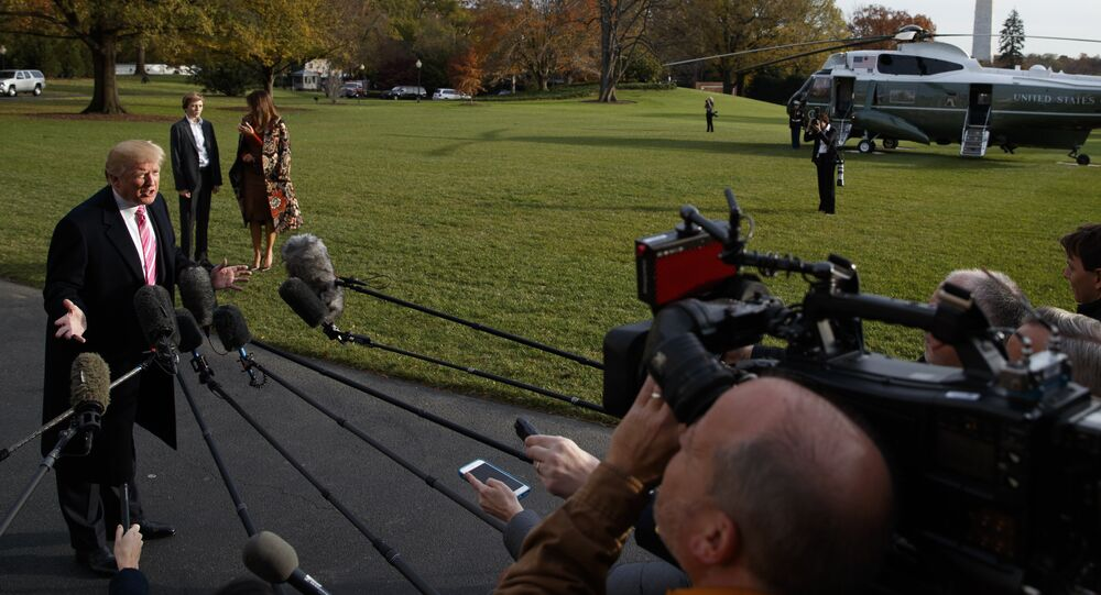 President Donald Trump speaks to reporters before leaving the White House, Tuesday, Nov. 21, 2017, in Washington for a Thanksgiving trip to Mar-a-Lago estate in Palm Beach, Fla.