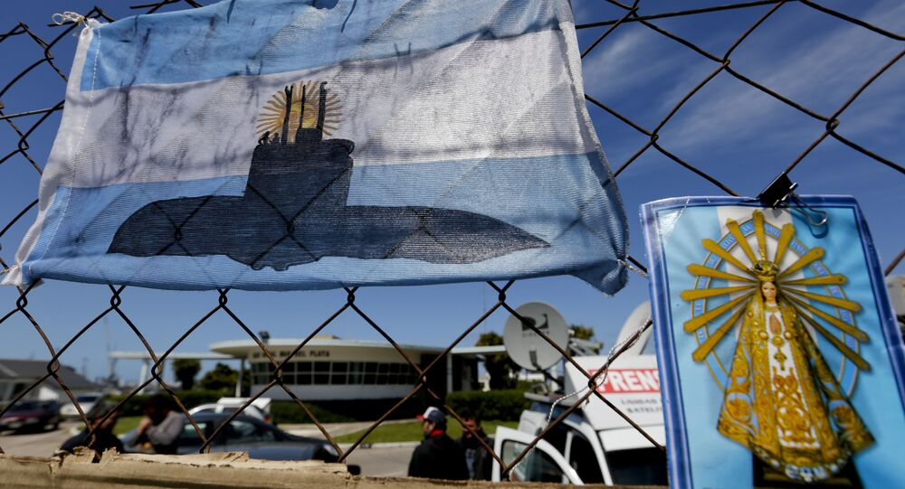 An Argentine national flag with a drawing of a submarine hangs from the fence surrounding the naval base in Mar del Plata, Argentina, Tuesday, Nov. 21, 2017