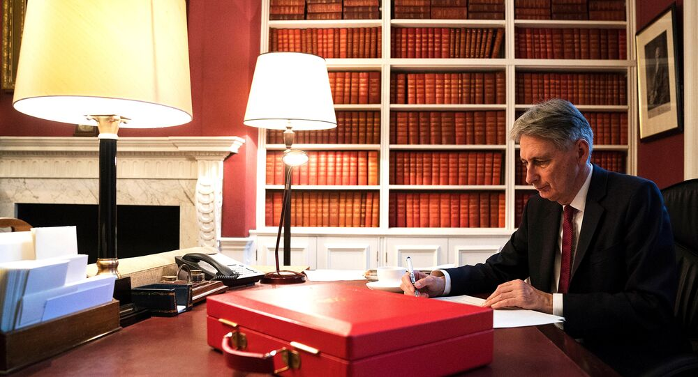 Britain's Finance Minister Philip Hammond prepares his 2017 budget speech in his office in Downing Street, London