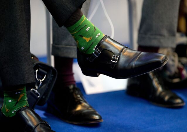 The shoes of Irish Prime Minister Leo Varadkar, left, during a round table meeting at an EU summit in Goteborg, Sweden on Friday, Nov. 17, 2017. European Union leaders warned Britain Friday that it must do much more to convince them that Brexit talks should be broadened to future relations and trade from December.