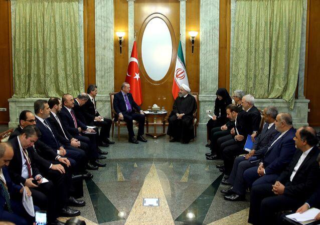 Turkey's President Tayyip Erdogan meets with Iran's President Hassan Rouhani in Sochi, Russia, November 22, 2017