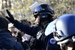 A police officer during a protest rally against changes to France's university admission rules, Paris