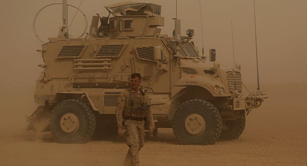 In this Monday, Nov. 6, 2017 photo, U.S. Marines prepare to build a military site during a sandstorm in western Anbar, Iraq. The US-led coalition's newest outpost in the fight against the Islamic State group is in this dusty corner of western Iraq near the border with Syria where several hundred American Marines operate close to the battlefront, a key factor in the recent series of swift victories against the extremists.