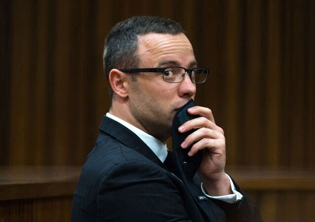 FILE - In this photograph taken on Tuesday, May 19, 2014, Oscar Pistorius listens to psychiatric evidence for his defense, during his ongoing murder trial in Pretoria, South Africa