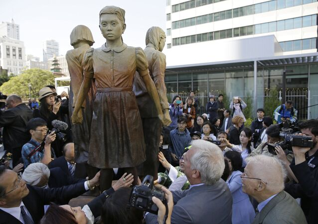 People move in to take a closer look at the Comfort Women monument after it was unveiled Friday, Sept. 22, 2017, in San Francisco