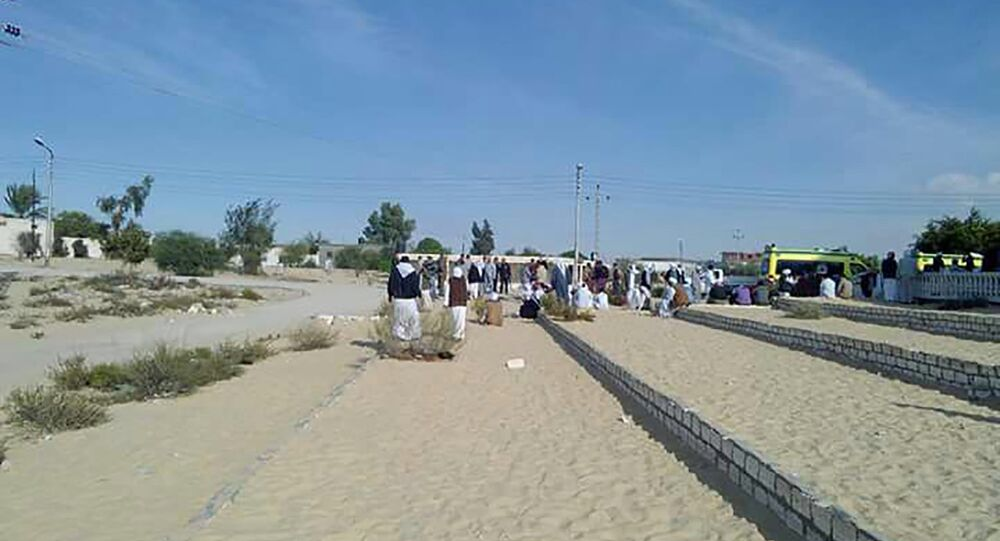 Egyptians gather outside the Rawda mosque, roughly 40 kilometres west of the North Sinai capital of El-Arish, following a gun and bombing attac