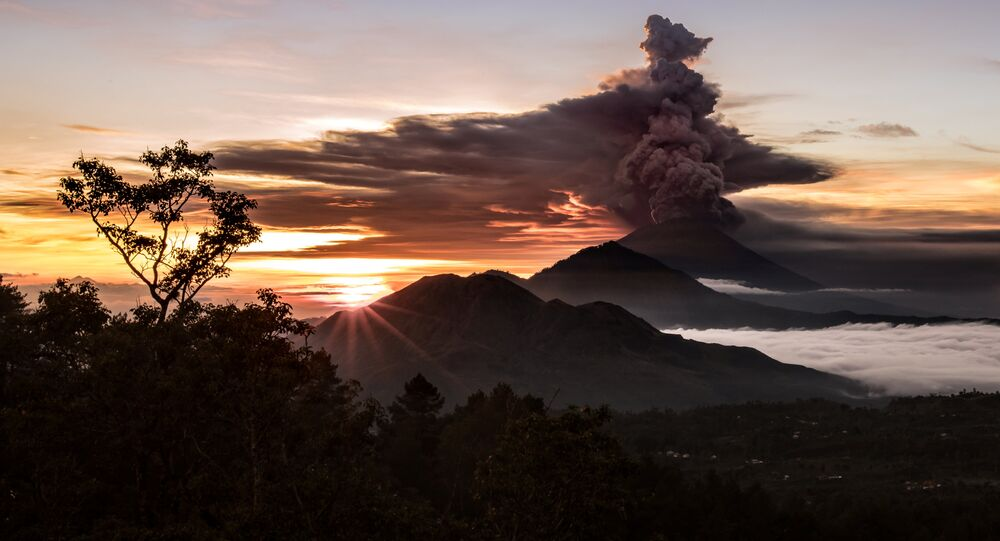 Mount Agung volcano is seen spewing smoke and ash in Bali, Indonesia, November 26, 2017 in this picture obtained from social media