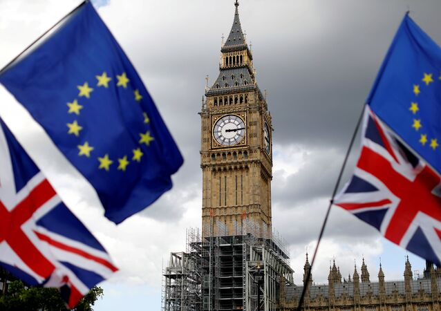 Union Flags and European Union flags fly near the Elizabeth Tower, housing the Big Ben bell, during the anti-Brexit 'People's March for Europe', in Parliament Square in central London, Britain September 9, 2017