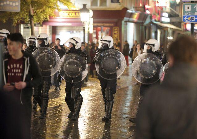 Belgian police march against demonstrators during unrest in Brussels on Wednesday, Nov. 15, 2017