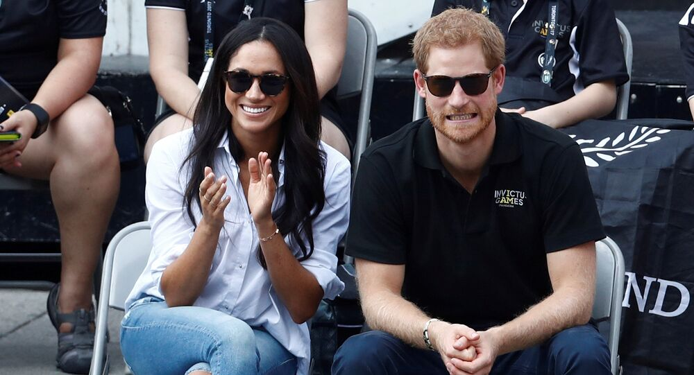 Britain's Prince Harry and his girlfriend actress Meghan Markle watch the wheelchair tennis event during the Invictus Games in Toronto, Ontario, Canada September 25, 2017.