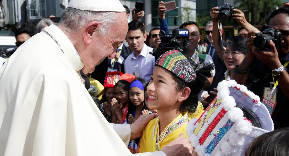 Pope Francis is welcomed as he arrives at Yangon International Airport, Myanmar